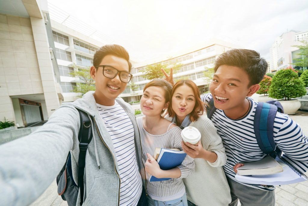Group of Vietnamese students taking selfie together
